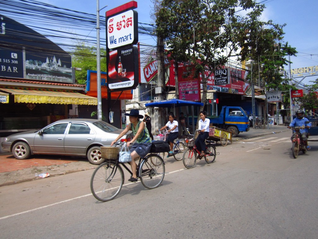 Cambodians using their most common forms of transportation