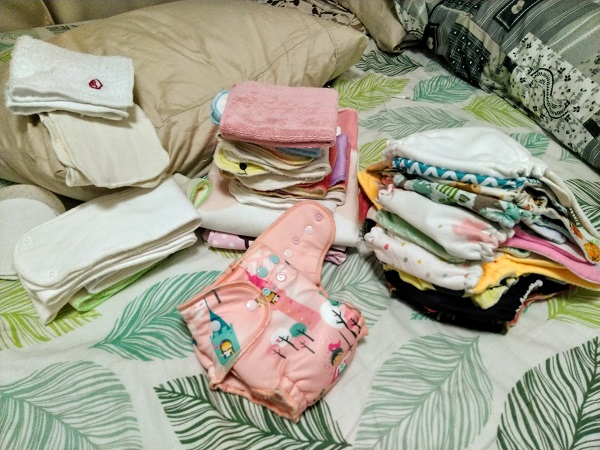 Pile of Cloth Diapers and Baby Stuff